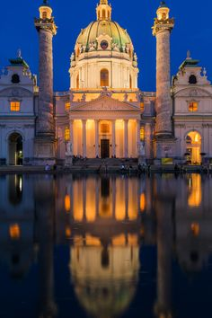 Karlskirche at the blue hour. Vienna, Austria - Church of Karlskirche reflected in the water at the blue hour. Middle East Map, Blue Hour, Vienna Austria, Taj Mahal, Travel Destinations, World, Building, Water, Traveling