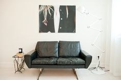 black worn-in leather sofa