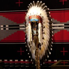 "This Victory Headdress is of a plains-style construction. Measuring in at over 36"" long, this piece is impressive in both size and craftsmanship. Each feather is carefully painted, and each bead is pa"