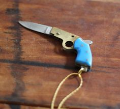 Gun Pocket Knife Necklace Brass Pistol with Turquoise Bakelite Handle.