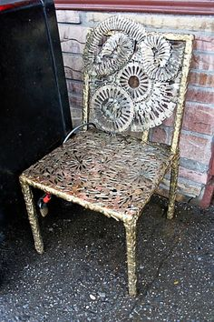 This chair is covered in metal keys and it sits outside a little locksmith shop on I think 6th ave, I used to pass by it all the time. If I remember correctly the wall and/or door is covered in keys too.
