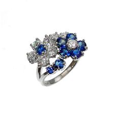 platinum, sapphire, and diamond flower ring.  Firestone and Parson Jewelers - Boston