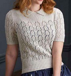 """Inspired by 1950s styles, Pat Menchini has created this soft and feminine blouse. It features a little collar, a buttoned opening at the back neck, short sleeves, and a pretty stitch motif. """"The 12-row lace pattern is quite simple to memorise, with four of the lace rows repeated and all wrong-side rows purled!"""" says Pat. She has used a lightweight cotton-silk yarn from Rico, which has a gorgeous feel and drape."""