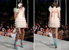 Masks and gowns filled the catwalk with Silvia Bours