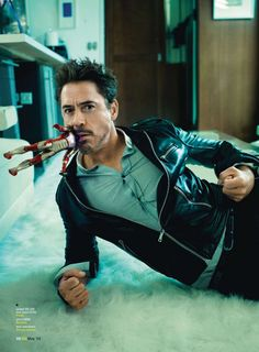 Robert Downey Jr - GQ by Peggy Sirota, May 2013 Looks like a Wolverine pose- cigar, clenched fists for the claws. Yyyyessh...