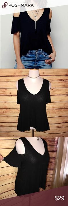 Free People Bittersweet Black Cold Shoulder Tee Super stylish on trend flowy cold shoulder tee with a BOHO edge. Great rich black shade with high low hemline. Perfect for spring/summer with shorts or a maxi. Excellent quality and condition. Check out my other listings to bundle and save! Free People Tops Tees - Short Sleeve