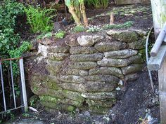 Easy Concrete Bag Retaining Wall. Stack up bags of concrete to form a wall. Hose them down with water. They harden and later the bags decompose leaving a super hard wall behind. No molds, no mixing, no pouring, no rentals, no mess! Don't like the look? You can cover it with a veneer later.