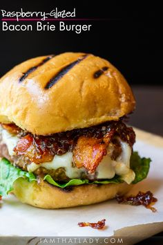 This Raspberry-Glazed Bacon Brie Burger is not your ordinary burger! The flavors blend SO WELL together - this might be the best burger you ever eat.
