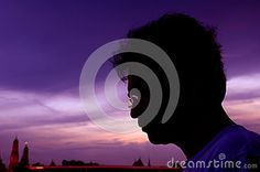 Silhouettes of a man wearing glasses.