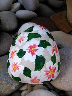 .Pretty flower painted rock!