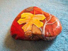 maple leaf painted on rock