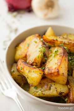 Greek roasted potatoes with onions and herbs ~scroll down for English version