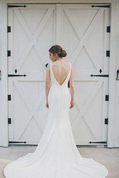 Sleek wedding dress with a V back | Photo by Elle Boone