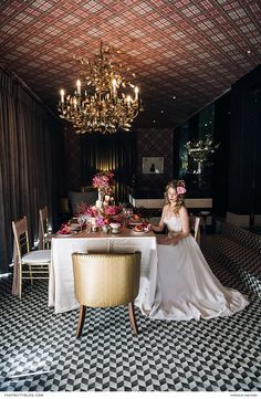 They were inspired by the venue's big red door, golden chandelier and Vivienne Westwood wallpaper.