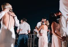 One of a set of images taken at this Italian destination wedding of Paris and Ray.  Set in the vibrant coastal town of Sorrento. Everyone enjoys dancing in the evening. Photography by Matt Porteous