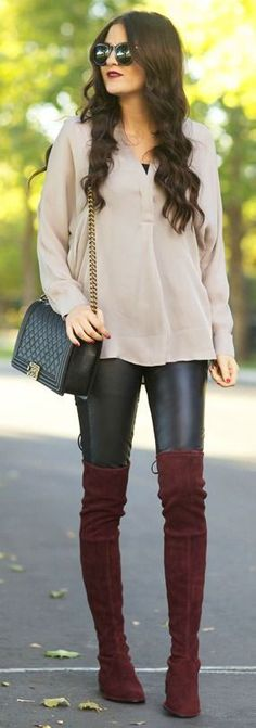 Over-the-knee boots look perfect with leather leggings and a long blouse.