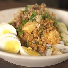 Pancit Palabok is a noodle dish with shrimp sauce and topped with several ingredients such as cooked shrimp, ground pork, smoked fish and peanuts!