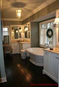 Decorating The Master Bathroom | Decor Love the tub and vanity, I'll assume there's a shower somewhere.
