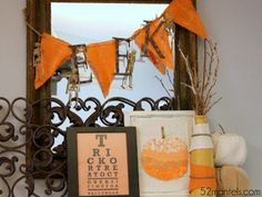 An orange-and-ivory color scheme and DIY decor—check out that candy corn-style vase!—dress up this mantel.