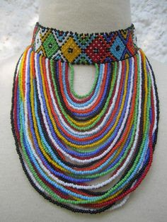 Beaded choker has a diamond design around the neck and the colors are masai colors. Dimensions: Drop approximately *Please measure your neck and let us know for a better fit. Diamond Solitaire Necklace, Diamond Pendant Necklace, Diamond Bracelets, Diamond Jewelry, Diamond Knot, Cartier Bracelet, Diamond Rings, African Necklace, African Jewelry
