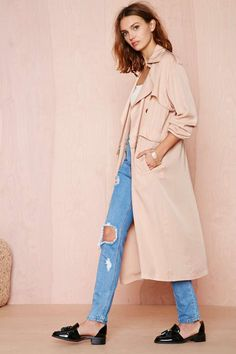 A convertible trench coat. Wear it long with jeans in the day, then zip off the bottom and wear it cropped with heels at night! / the love assembly