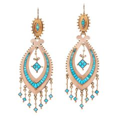 Victorian Rose Gold Turquoise Chandelier Earrings. Turquoise cabochons adorn a 14 karat rose gold fringe earring measuring approximately 3-1/4 inches in length and 1 inch wide. Circa 1880s