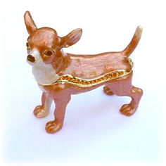 Who wouldn't love this adorable Chihuahua? Its sparkling eyes, and smiling face, make this box irresistible. We've fashioned it from fine pewter, then meticulously hand enameled it for accuracy. We detailed this piece in 24 Karat gold. Finally, it's been hand set with amber colored, Swarovski Crystals to create lots of sparkle! Truly, a special piece. See more images below, and click on them to enlarge for better viewing.