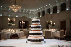 Orange, black and white wedding cake