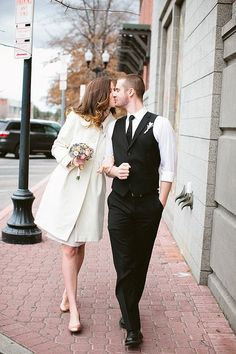 Bride and groom heading to their courthouse wedding: