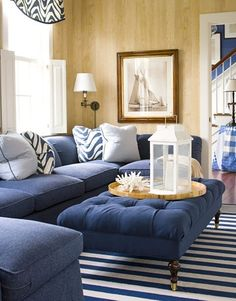 Nautical inspired blue and white coastal living room with great striped rug.