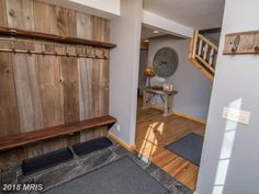 This Deep Creek Lake vacation home has a wonderful mud room! With awesome wood accents, a dark tile floor, and railroad ties for hooks, it gives a rustic feel with a modern finish!
