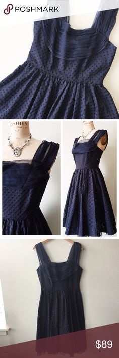 """Anthropologie 'Peggy Sue' Fit & Flare Dress 10 Anthropologie 'Peggy Sue' Dress by Girls from Savoy. Size: 10. Retail: $188.  ▫This dress is the epitome of 1950's glam! Features a feminine silhouette with a nipped in waist & full A-line skirt. ▫Navy blue color with textured check pattern. ▫Flouncy crinoline layer peeks out underneath skirt hem.  ▫Scoop neck with draped, pleated crinoline detail blends into sheer crinoline straps.  ▫Concealed back zip. Fully lined. ▫Bust: 35"""" Waist: 30""""…"""