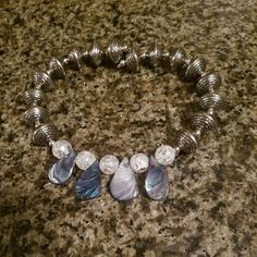 Awesome Bohemian Necklace. Polished shells, cracked glass beads, and silver deco beads. Handcrafted choker style with high quality memory wire. One size fits all.