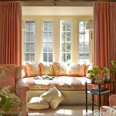 Bay window seat with curtains to turn it into a private hideaway