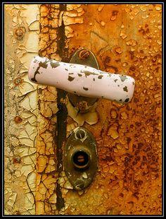 door knob on a rusty rail car