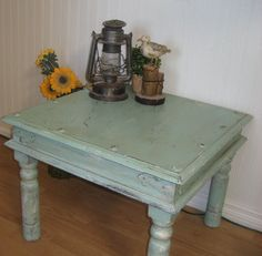 Beautiful, coastal inspired side table, freshly refinished in a chalk paint mix to resemble seafoam blue/green. I gave this piece a crackled, saltwash finish with soft white and mustard undertones. A beautiful old weather worn appearance with textured layers. The top is treated to a clearcoat finish then I applied a light finish in dark wax here and there...very subtly... then clear wax, giving it a warm, timeworn appearance.
