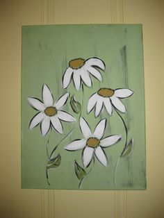Light green canvas painting with daisies