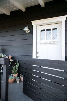 Benjamin Moore Paint: Siding: Aura exterior in flat Onyx Black Trim: Aura exterior Grand Entrance in satin Oxford White 869 Black House Exterior, Exterior Front Doors, House Paint Exterior, Exterior Paint Colors, Exterior House Colors, Paint Colors For Home, Interior Exterior, Exterior Design, Exterior Trim