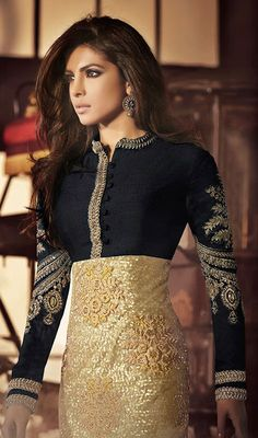 Be perfect example for classic style like Priyanka Chopra donning this black and gold color net bhagalpuri silk churidar suit. Ethnic resham, sequins, silver zardosi and stones work within clothing adds a sign of attractiveness statement for look. #PriyankachopraCollection