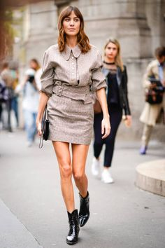 Alexa Chung wears a checkered dress outside Stella Mccartney during Paris Fashion Week Womenswear Spring/Summer 2018 on October 2 2017 in Paris France