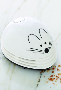 This is the only mouse that your friends will be happy to see in their house. The adorable vacuum is made to keep kitchen counters and tables spotless. Available in two colors, you may want to get one of these handy tools for yourself too. Crumb Catcher Vacuum, $11.99; ContainerStore.com  - WomansDay.com