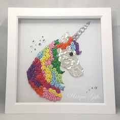 Unicorn Button Art Frame White natural wood frame 8 × 8 in / 20 × 20 cm Handmade, using buttons and acrylic gemstones. £45 plus postage & packaging https://www.etsy.com/uk/shop/UniqueGiftsButtons https://www.facebook.com/unique.gifts.buttons
