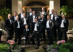 Formal groomsmen outfit idea - matching black tuxedos and white rose boutonnieres {Greer Photography}