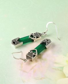 These exquisite ethnic design earrings, inspired by an antique Eastern scabbard, combine green adventurine quartz shafts with patinated beaded endings in patterned sterling silver. Fastened by sterling silver hooks. Buy for A$55 (less 10% email signup discount) at Cybelle.com.au