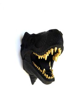 ****DISCOUNTED 20% OFF IN ADDITION TO THE BLACK FRIDAY COUPON CODE: CYBERSALE16 WAS $145.00**** What a unique gift idea for a dinosaur fanatic! This matte black t-rex head is a unique conversation piece. It would look great on the wall of a fun-loving outrageous trend-setter. It has been hand-painted matte black and the teeth have been painted gold for a little extra bling! Show off your love for animals by displaying this beautifully crafted and detailed resin t-rex head, which of course…