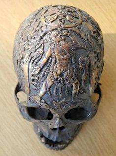 Tibetan carved skull depicting Sarvabuddhadakini & the Dharmachakra wheel