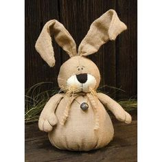 Burlap Bunnyis stuffed and has bendable ears for easy posing. It has raffia and bell accents, and a weighted bottom. Bunny measures 15\ tall.