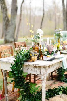 Rustic wedding table full of geodes: http://www.stylemepretty.com/north-carolina-weddings/asheville/2014/06/09/bohemian-inspiration-shoot-2/ | Photography: Michelle Lyerly - http://www.michellelyerly.com/