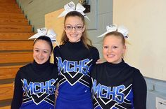From left, Moffat County High School cheerleaders Katie Haskins, Laura Bolton and Cassidy Griffin band together before Saturday's regional championship games for MCHS boys and girls. The trio kept spirits high for the Bulldog varsity teams, with the girls gaining a win and a trip to the Great 8 round of the 3A CHSAA State Playoffs. March 2015