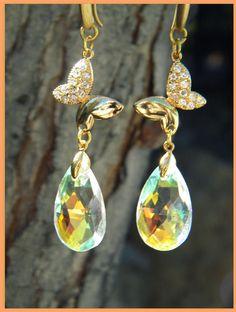 aros de mariposas de  oro con diamantes bellisimos !!!!